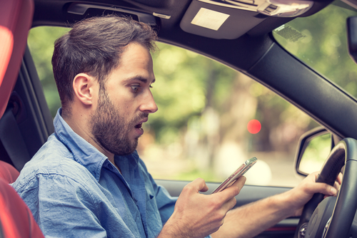 A man texting and driving