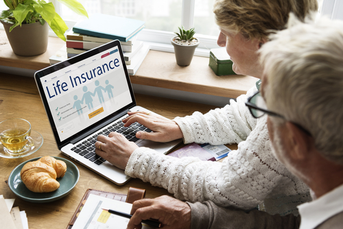 An older couple signing up for life insurance