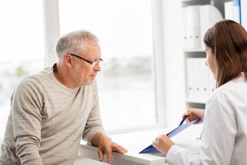 An older gentleman looking at Medicare coverage