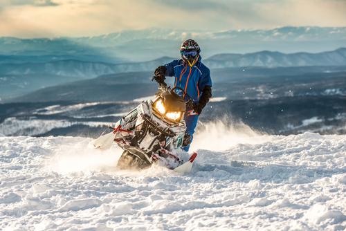 Someone riding a snowmobile