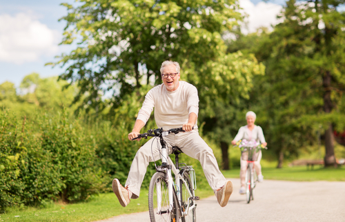 An older couple riding bikes after getting life insurance